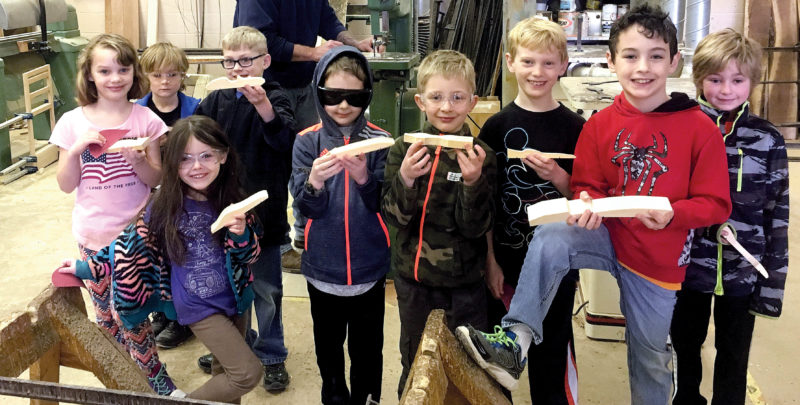 The Inter-Mountain photo by Heather Bonnett Cub Scouts from Troop 88 cut out pinewood derby cars Saturday at the Randolph Technical Center with the assistance of building trades teacher Albert Chewning. Kids in attendance include Sarah Lipscomb, Kyan George, Kayla Harris, Isaac Shepler, Corin Hyde, Toby Wagoner, Daniel Lipscomb, Andrew Harris and Kaden George.
