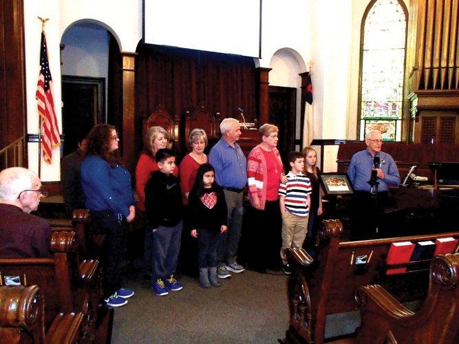 Bob Cowgill, logistics coordinator for the Elkins area Operations Christmas Child Volunteer Team, right, presents First Baptist Church in Buckhannon an award for its service as a drop-off location.