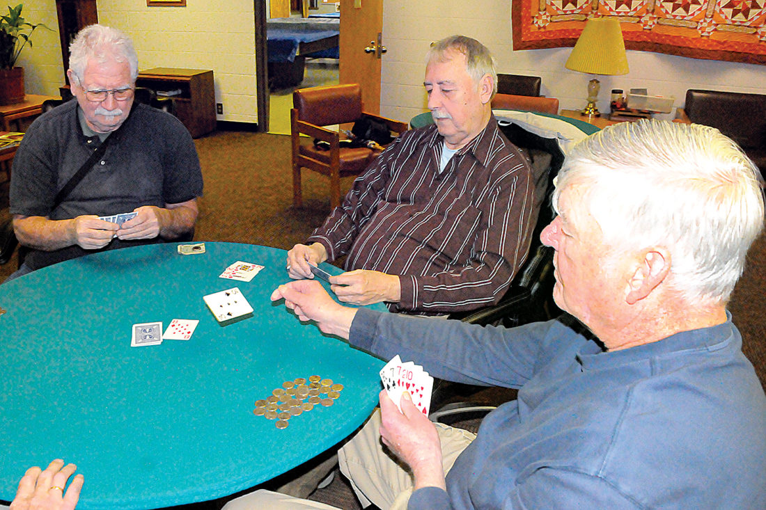 The Randolph County Senior Center is a meeting place for many area residents, including a group of friends playing tonk, a card game similar to rummy. Enjoying the game Tuesday are, from left, Carol White, Tom Nesbitt and Floyd Thomas.