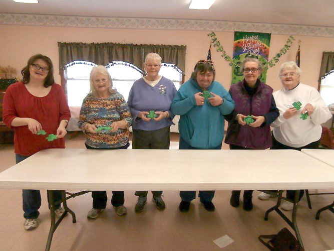Submitted photo Nellie Workman, Ida Workman, Mary Grado, Virginia Popio, Lorraine Hinkle and Arlene Ramsey enjoy making shamrock magnets for St. Patrick's Day at the Parsons Senior Center.
