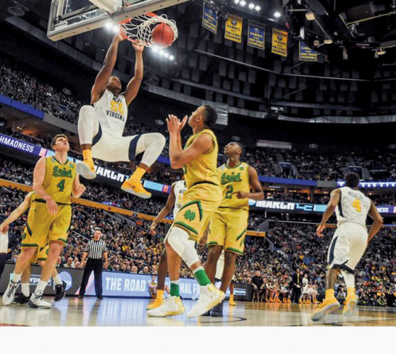 Photos courtesy of West Virginia University Sagaba Konate slams for two points against Notre Dame Saturday at the KeyBank Center in Buffalo, New York. The Mountaineers won to move onto the Sweet 16.