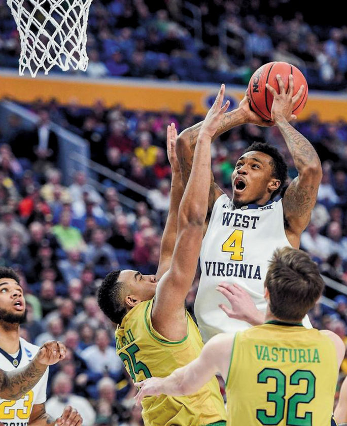 Daxter Miles Jr. scores two of his 18 points against Notre Dame Saturday at the KeyBank Center in Buffalo, New York.