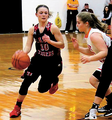 Submitted photo Union High School's Colleena Burdock dribbles the ball toward the basket during a game this season
