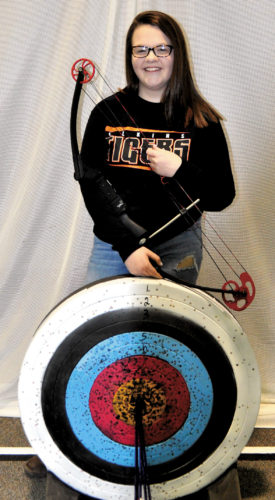 The Inter-Mountain photo by Lydia Rhodes Elkins High School sophomore Jesse Tallman prepares for the state archery competition, set for Saturday at the Charleston Civic Center