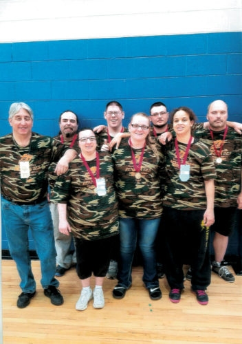 Submitted photos The Randolph County Special Olympics basketball team won first place in their division at the West Virginia Special Olympics Basketball Tournament in Morgantown. The athletes and organizers would like to thank their sponsors for making it possible for the team to attend. Front row from left are Karah Currence, Shawnta Bumgardner and Laura Jones; and back row from left are Coach Dave Perry, Rodney Simmons, Charles Wine, Timothy Wood and Dale WingfieldSubmitted photos The Randolph County Special Olympics basketball team won first place in their division at the West Virginia Special Olympics Basketball Tournament in Morgantown. The athletes and organizers would like to thank their sponsors for making it possible for the team to attend. Front row from left are Karah Currence, Shawnta Bumgardner and Laura Jones; and back row from left are Coach Dave Perry, Rodney Simmons, Charles Wine, Timothy Wood and Dale Wingfield