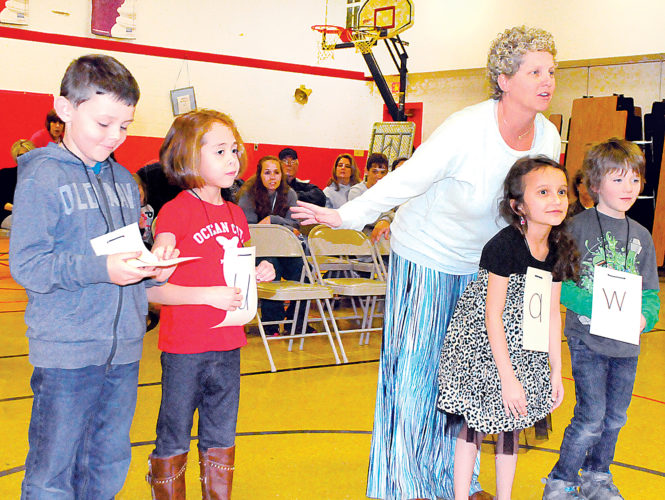 Students from Christi Phillips' first-grade class at George Ward Elementary School perform skits about letters during Tuesday night's Randolph County Board of Education meeting in Mill Creek. Kindergarten students from Chasity Sharp's class also performed.