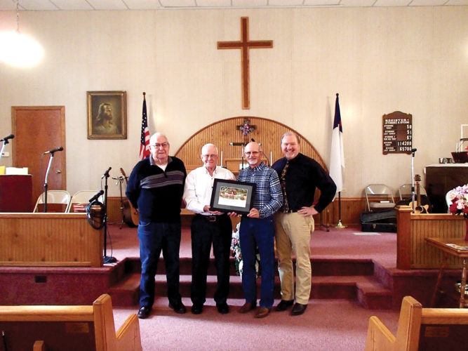 Pictured from left are Tallmansville Baptist Church Decan Tom Bailey, Elkins Operation Christmas Child Logistics Coordinator Bob Cowgill, Decan Tim Wood, and the Rev. Tim Lewis.
