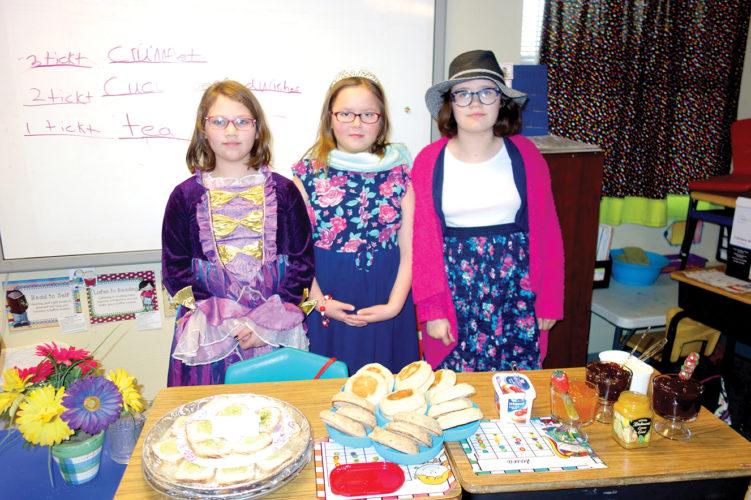 Serena Hostetler, Maria Prindle and Elizabeth Brake offer British cuisine at their food booth.