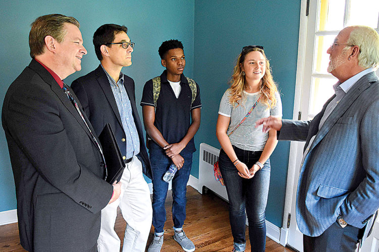 During a visit to the Morrison-Novakovic Center for Faith and Public Policy, David Morrison, right, speaks with D&E President Chris A. Wood, Director of the Morrison-Novakovic Center Dr. Bryan Wagoner and students Thabo Madzimure and Shirley Fox.