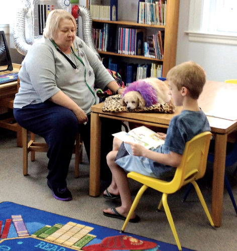 Submitted photos Barrett reads to Therapy dog Brenda Lee and owner Barbara Higgins at the Philippi Public Library during Dog Tales — Reading to Mountaineer Therapy Dogs