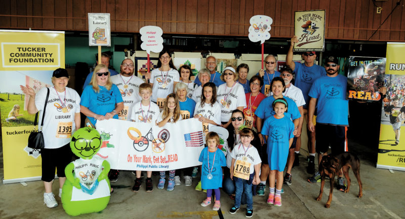Submitted photo The 2016 Philippi Public Library 'Bookworms' team for the Tucker Community Foundation Run For It gathers. Plans are underway for the 2017 event.