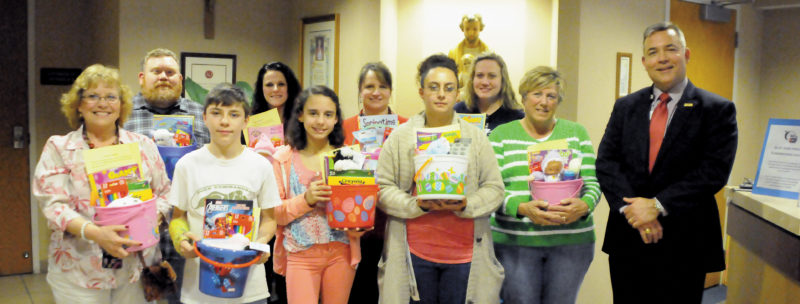 The Inter-Mountain photo by Beth Henry-Vance Student representatives from Buckhannon-Upshur Middle School's Project ISAAC after-school program donate Easter baskets Thursday to St. Joseph's Hospital. In front, from left, are Carolyn Blend, Project ISAAC site coordinator; students Robert Vaught and Breanna Perry; parent Thelma Gordon; Debbie Shapiro, Project ISAAC volunteer; and Skip Gjolberg, administrator of St. Joseph's Hospital. In the back, from left, are parent Mike King; and St. Joseph's employees Candy Lewis, Janet Phillips and Misti Elmore