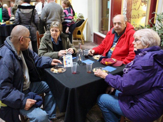 The Inter-Mountain photo by Brooke Binns Festival Friday attendees enjoy conversation with one another and appetizers provided by Henry G's Cafe at the Seneca Mall in downtown Elkins April 7. From left are Doug Lewis, Sue Lewis, Richard Hyson and Norma Fitzwater.
