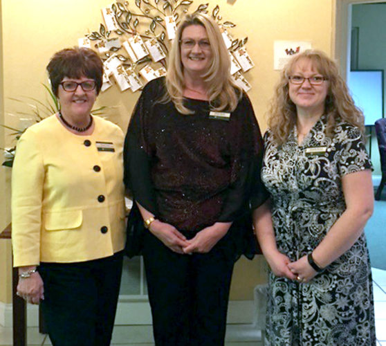 Submitted photo A new management team has taken over at Colonial Place in Elkins. Members of the team are, from left, Sharon Teter, community relations manager; Diana Smith, executive director; and Michelle Barnett, resident care manager.