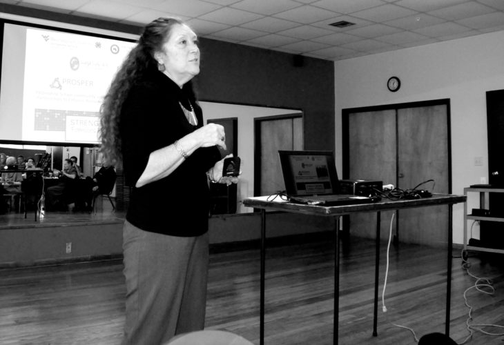 Cindy Nucilli, community outreach worker for the Strengthening Families Program, speaks Monday to members of the Rotary Club of Elkins. The local program at Elkins Middle School is one of only two in the state.