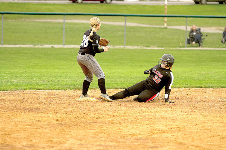 Elkins' Madison Wagner slides into base safely during the Lady Tigers' 7-3 loss to North Marion Tuesday.