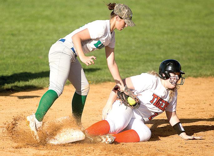 Elkins sophomore Addison Huffman slides into third base Wednesday afternoon.