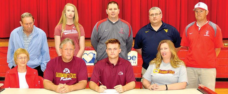 Taking part in Tygarts ValleyHigh School senior Rece Wamsley's signing to play baseball for Fairmont State are, bottom row from left, his grandmother Janice Wamsley, his father Steve Wamsley, Rece and his mother Lisa Wamsley; and back row from left, his grandfather Andy Wamsley, his sister Tatum, TVHS athletic director Michael DiPasquale, Post 29 American Legion coach Chris George and TVHS baseball coach James Markley.