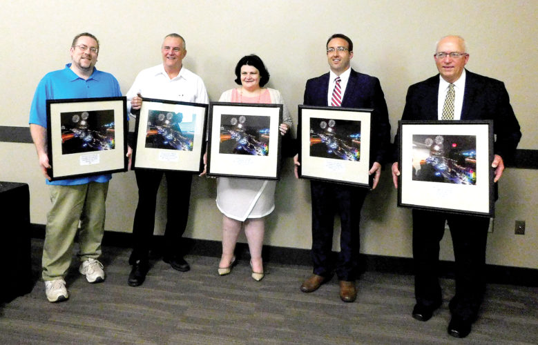The Buckhannon-Upshur Chamber of Commerce honored local businesses and business men and women for their impact to the development of the bettering of the community and it's people. Awards included, from left, Business of the Year, awarded to The Sign Guy and presented to Daniel Marsh; Organization of the Year, awarded to Create Buckhannon and accepted by CJ Rylands; Business Woman of the Year, awarded to Amanda Hayes; Business Man of the Year, awarded to Rob Hinton; and Citizen of the Year, awarded to Buck Edwards.