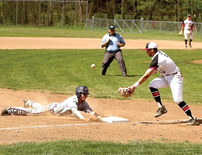 A Malone baserunner slides into third as D&E's Michael Wood tries to haul in the relay from the outfield.