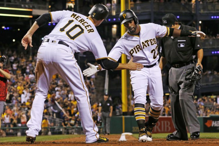 Pittsburgh Pirates' Andrew McCutchen (22) celebrates with Jordy Mercer (10) after hitting a three-run home run off Seattle Mariners relief pitcher David Rollins during the eighth inning of a baseball game in Pittsburgh, Wednesday, July 27, 2016. The Pirates won 10-1. (AP Photo/Gene J. Puskar)