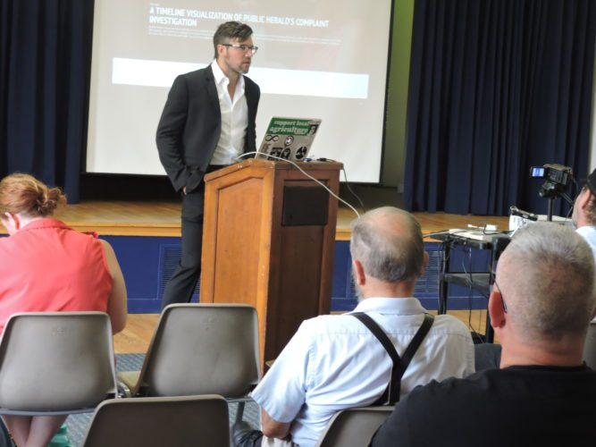 Joshua B.  Pribanic, editor in chief of The Public Herald, speaks about the importance of looking into  complaints and investigations Saturday at Olney Friends School.
