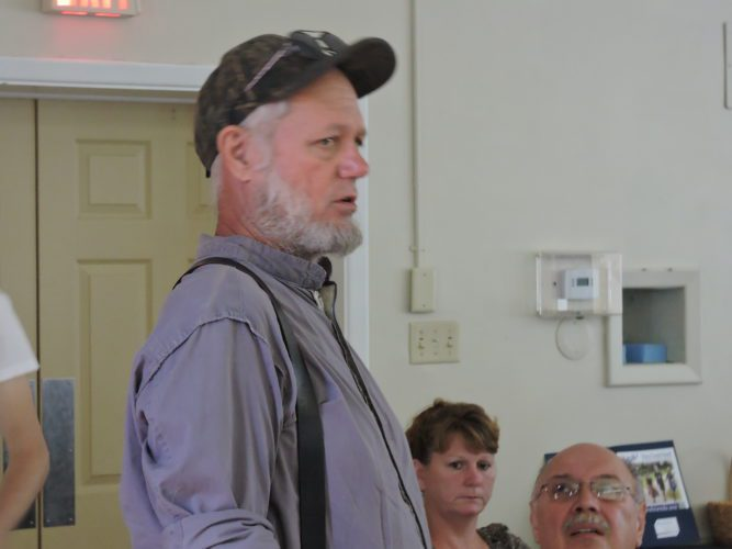 T-L Photos/ROBERT A. DEFRANK Kevin Roberts, of  Barnesville, asks questions about the Yale study's sampling process and possible local impact.