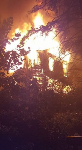 Photo by Eric Smith A Jacquette Street home burns late Thursday in Bridgeport.