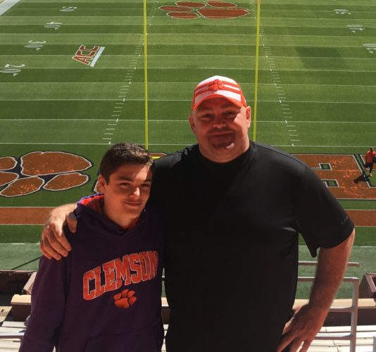 Photo Provided  MARTINS FERRY Police Chief John McFarland and his son, Richie, stand inside Clemson's Memorial Stadium prior to the Tigers' spring game.