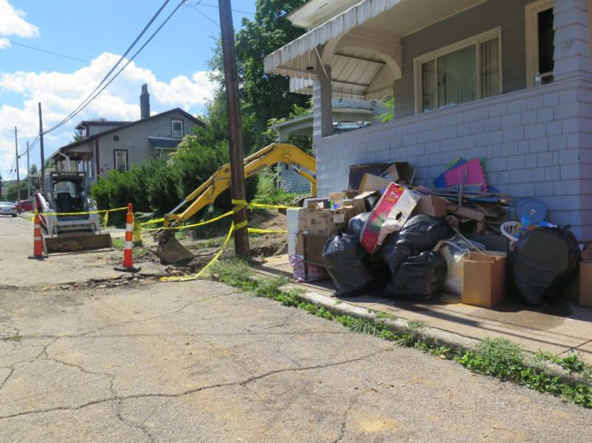 Photo by Joselyn King / Bellaire village workers and residents worked throughout the day Sunday in the area of 3714 Monroe St. to clean up after a massive 20-inch waterline break Saturday evening.