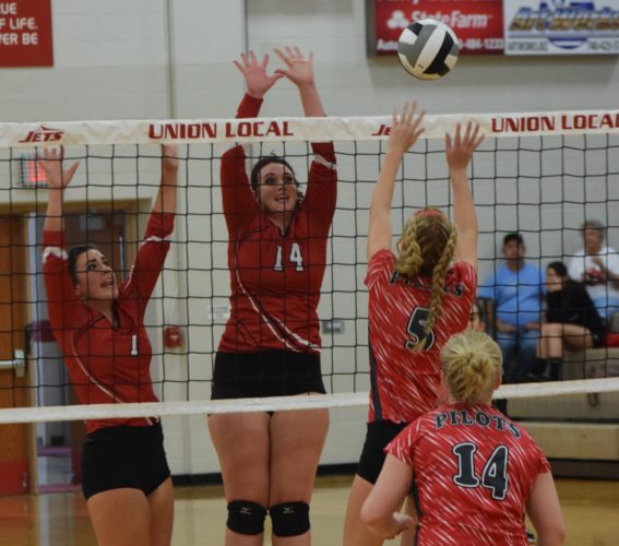 T-L Photo/SETH STASKEY  UNION LOCAL'S Kaitlynn Clark-Patterson (14) and Katie Bashline (1) go up to block a shot of River's Macy Ladyga during Monday's mutual season opener in Morristown. The Jets prevailed in straight sets, 25-8, 25-12 and 25-18.