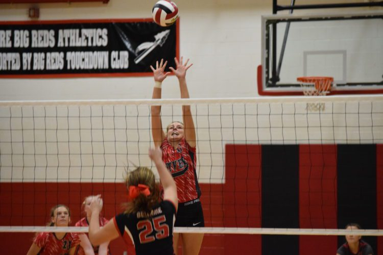 T-L Photo/KIM NORTH RIVER'S BAILEY Caldwell lines up one of her 12 kills during Tuesday night's volleyball match with homestanding River. The Pilots won in three sets to even their record at 1-1.