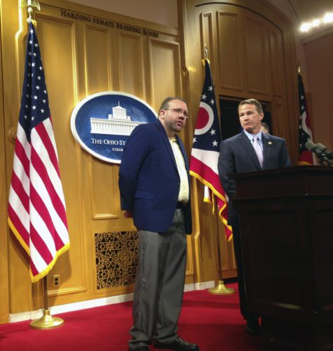 AP Photo Ohio Secretary of State Jon Husted, right, joins Jason LaMar in taking questions from the media about an iBook LaMar helped to create, during a news conference in Columbus, Ohio, Tuesday.