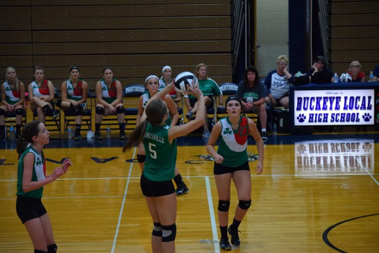 T-L Photo/RICK THORP BARNESVILLE'S Mindi Wehr (5) sets up a shot for teammate Astin Skinner (23) during Wednesday night's prep volleyball match against Buckeye Local. The Shamrocks won in three games.