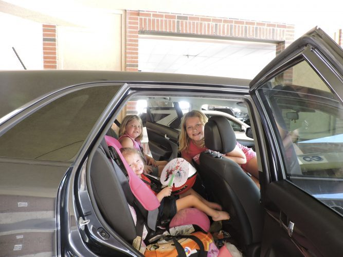 The Dutton girls enjoy a free car seat inspection. From center; Camryn, 2, Rilee, 7, and McKenna,