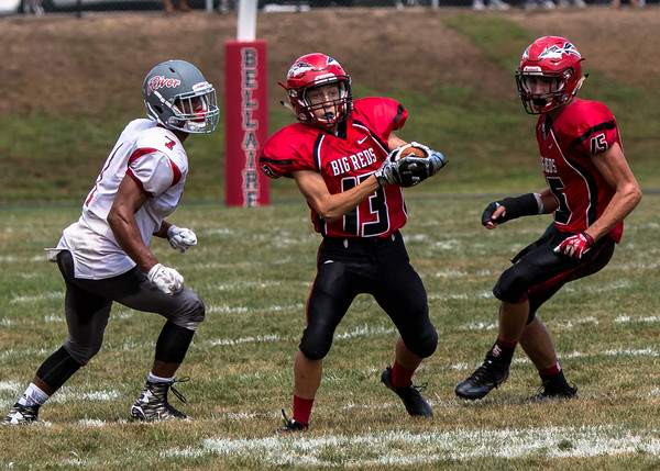 Photo/SHERI McANINCH BELLAIRE'S A.J. McCarthy (13) intercepts a River pass Sunday as the Pilots' Parker Caretti, left, and the Big Reds' Justyn Keyser (15) look on.