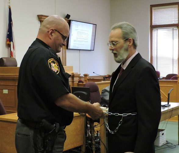 T-L Photo/ JANELL HUNTER - Sheriff Rick Shipp restrains John J. Peterson Jr., accused of 14 counts of child rape, attempted rape, gross sexual imposition and endangering  children Monday after his first day of trial in Monroe County Court.