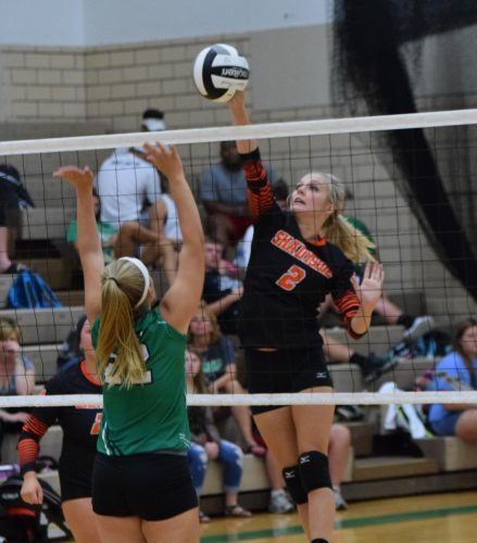 T-L Photo/SETH STASKEY  SHADYSIDE'S Kelsey Chimley goes up for a kill as St. John Central's Kate Lovinski attempts to block during Monday's match in Bellaire. The Tigers swept the Irish to improve to 3-0.
