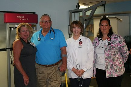 Photo Provided Pictured at the Cardiovascular and Pulmonary Rehabilitation facility at East Ohio Regional Hospital are, from left, Lynn Swider, director of the Cardiovascular and Pulmonary Rehabilitation Program; Joseph Gabis, M.D. and Medical Director of the Cardiac Rehabilitation Program at EORH; Libby Miller, registered nurse and coordinator of the Cardiac Rehabilitation Program; and Kayla Seidler, exercise physiologist.