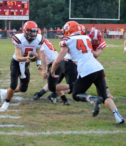 Shadyside's Connor Banco gets ready to take the handoff from Billy Johnson Friday night.