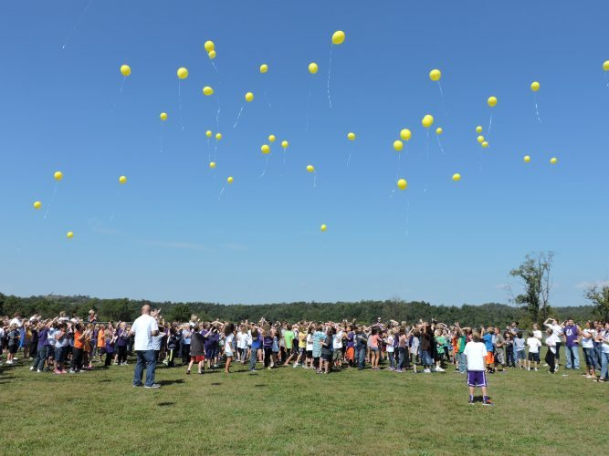 T-L Photo/SHELLEY HANSON AYERS ELEMENTARY School students launch yellow balloons for Childhood Cancer Awareness Month on Friday