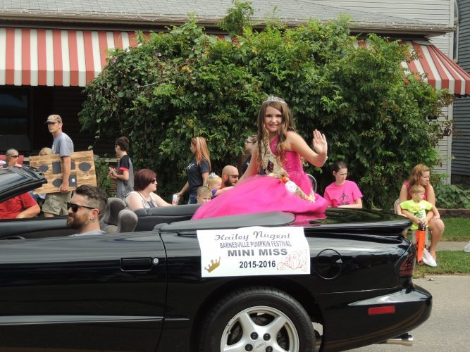 : Barnesville Pumpkin Festival Mini Miss Kailey Nugent appears in the Giant Pumpkin Parade.