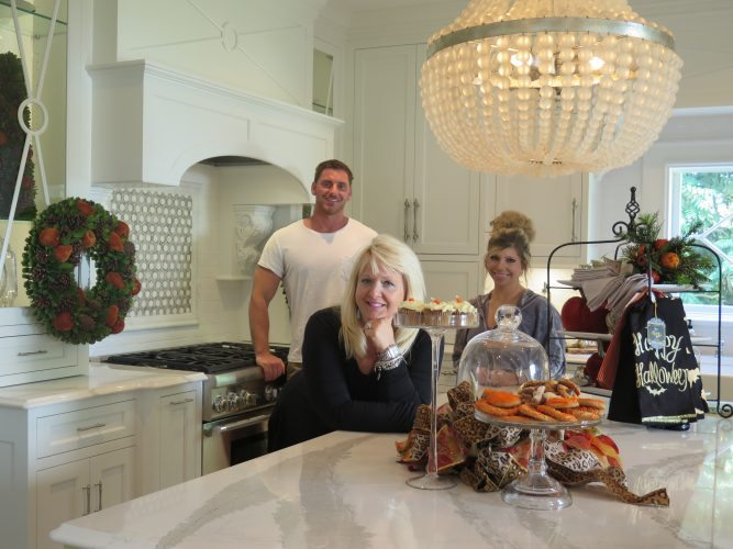 Photo by Joselyn King Kelly Cappelletti, front, principal designer at Kelly's Suite II in St. Clairsville; Darek Wilson, main designer; and Erica DeFilippo, design assistant, show off the chef's kitchen found at their new design studio, located at 235 West Main St. in St. Clairsville.