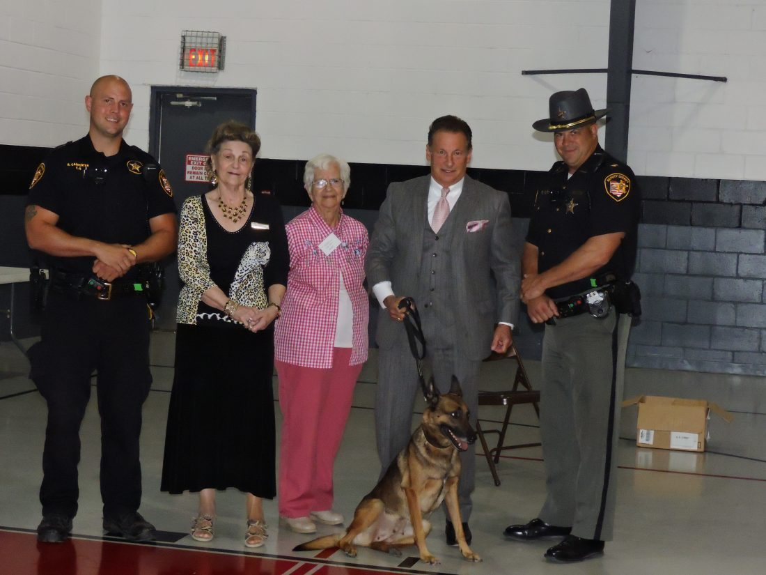 T-L Photo/ROBERT A. DEFRANK A K-9 unit from the sheriff's office gives a demonstration for the local chapter of the American Association of Retired Persons.  Pictured, from left, are K-9 Officer Brian Carpenter,  Jan Martin, AARP program director, AARP member Alma Stoica, Belmont County Common Pleas Judge Frank Fregiato and Chief Deputy James Zusack.