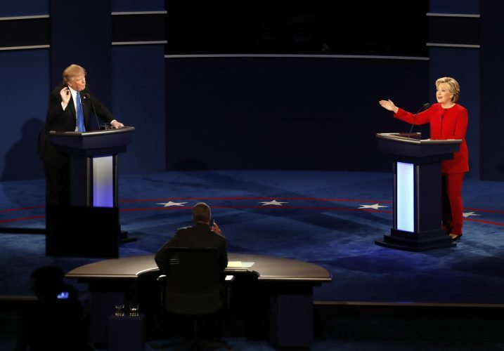 AP Photo - Republican presidential nominee Donald Trump and Democratic presidential nominee Hillary Clinton gesture during the presidential debate at Hofstra University in Hempstead, N.Y., Monday.