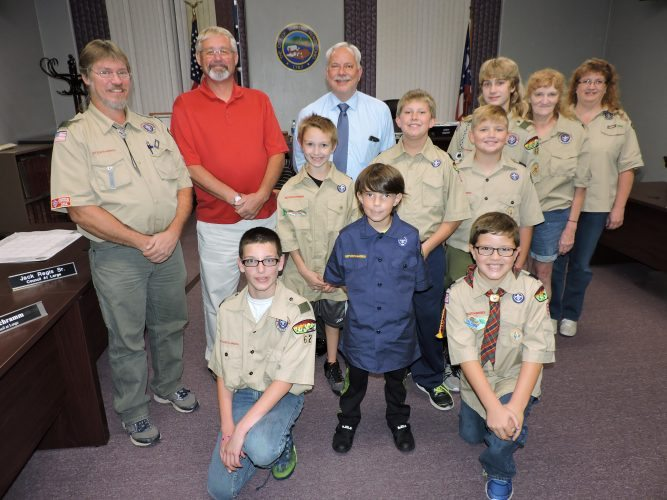 T-L Photo/SHELLEY HANSON MEMBERS OF Boy Scout Troop 62 of Martins Ferry gather around Mayor Robert Krajnyak after Wednesday's regular meeting. Front from left are Devon Green, 12; Alden Miller, 10; Wyatt Cunningham, 9; and Joey Secrist, 10; center, from left, Paul Toohey, scout master; Councilman James Schramm, who belonged to Troop 62 as a child; Krajnyak; Scott Meeker, 11; Walker Romshak, 10; Francis Toohey, 13; Mary Ellen Miller, den leader; and Joy Reynolds, cub master.