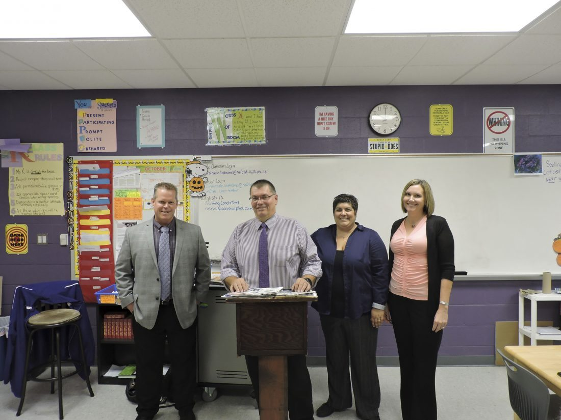 Martins Ferry High School Principal Jim Fogle, left, and English teacher Sherry Kapolka, right, stand with Joe Lovell and Kim Collette from The Times Leader as they speak to a class on Career Day.