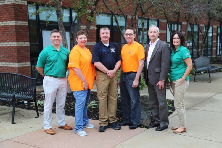 Photo Provided From left, Liam McConvile, Hess Utica lead; Ailsa Vogelsang, Belmont College EMS/fire safety coordinator; Curtis Kyer, EMS fire safety program assistant; Paul Gasparro, Belmont College president; Rob Williams, Hess operations manager; and Glenda Harlan, Hess social responsibility chair gather during the Shale Safety Institute.
