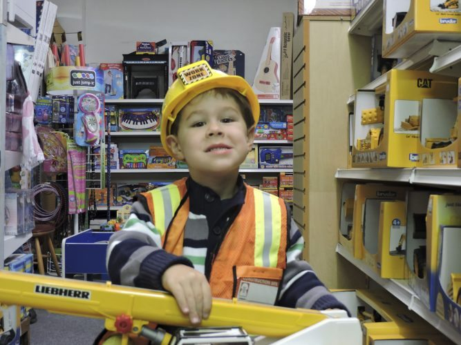 T-L Photo/DYLAN McKENZIE  Matthew Kendall, 3, dresses up in a construction worker costume at Deluxe Toy and Hobby in Martins Ferry. Parents are advised to choose warm costumes for their trick-or-treaters, with reflective elements if possible.
