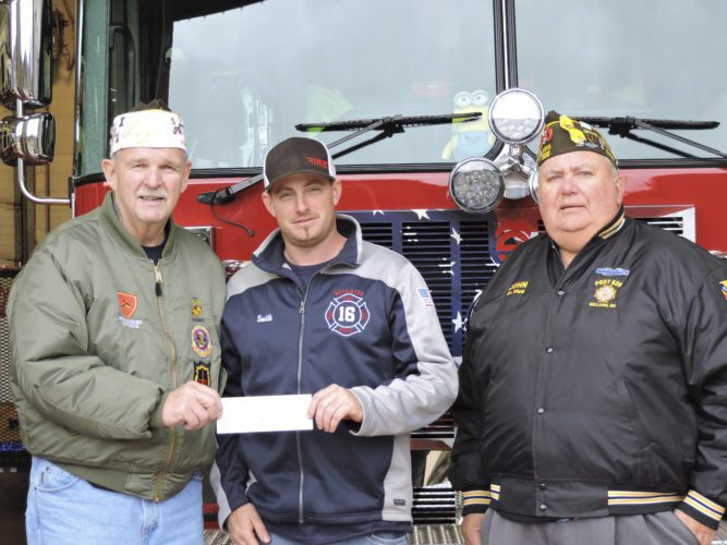 Bellaire VFW Post 626 Commander Terry Wildman, from left, stands with Bellaire Volunteer Fire Department Chief Ricky Smith and VFW Senior Vice Commander John Fodor. Wildman and Fodor presented Smith with a $500 check on Thursday, which Smith said will be used for equipment and training.     T-L Photo/DYLAN McKENZIE